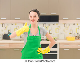 the kitchen is squeaky clean - cleaning woman happy and...