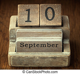 A very old wooden vintage calendar showing the date 10th Septemb