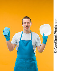 squeaky clean plate - happy man in apron holding clean...