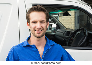 Smiling man in front of delivery van - Portrait of smiling...