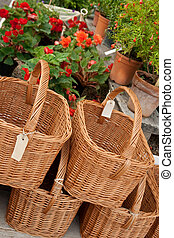Baskets with blank labels in a flower shop