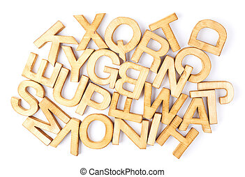 Surface covered with multiple wooden letters as a typography...