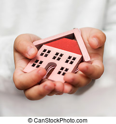 House In The hand - House model in the child hand.Investment...