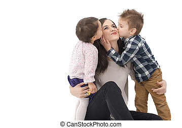 little girl and boy kissing their mother