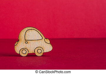 Wooden car icon on red background