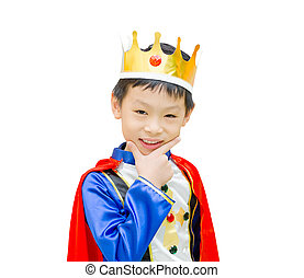 Asian boy is dressed in suit of a prince standing over white bac