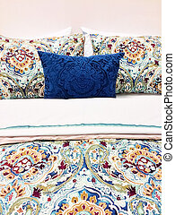 Colorful bed linen with floral design - Close-up of a bed...