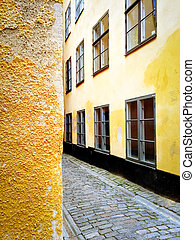 Bright yellow buildings in the old center of Stockholm -...