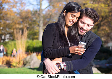 Couple in love looking at cellphone