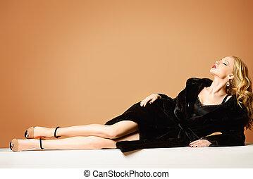 black mink - Beautiful blonde woman wearing mink fur coat....