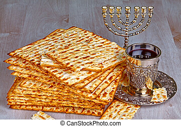 matzo with kiddush cup of wine - Closeup of Matzah on Plate...