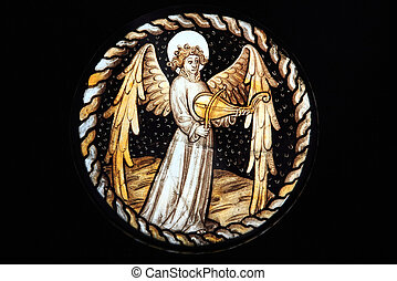 Angel, Stained Glass Window - An Angel playing a rebeck...