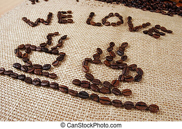We Love Coffee two coffee cups beans on a burlap fabric