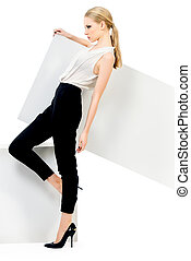 slender model - Fashionable female model posing at studio...