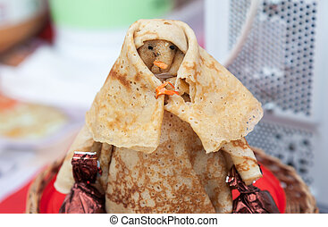 Shrovetide effigy made of pancakes close up Russian...