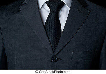 Dark business suit with a tie