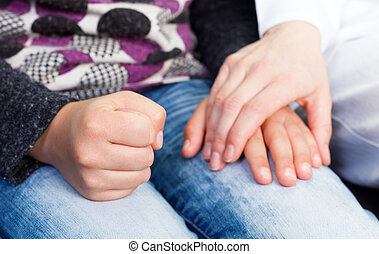 Reassuring hand - Photo of young doctor hand on the child...