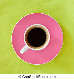 Morning coffee - A cup of coffee over the green background