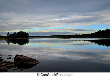 White nights. Northern Karelia, Russia - Romantic sunset,...