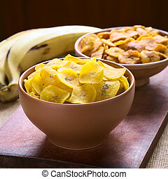 Salty and Sweet Plantain Chips - Bowls of salty (front) and...