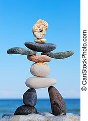 Symbolical - Artistic figurine of stones on the against blue...