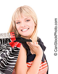 shopper - happy plus size woman with shopping bags over...