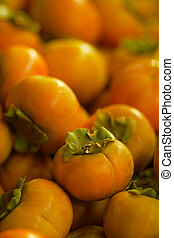 persimmon fruit - Pile of persimmon fruit for sale at the...