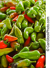 Red and Green Jalapeno Peppers - A pile of Red and Green...