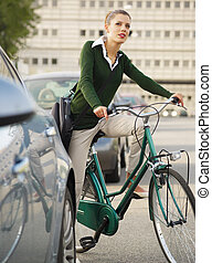 woman commuting on bicycle and looking away