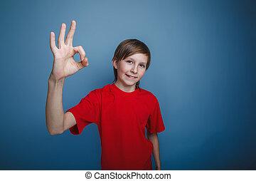 teenager boy twelve years old European appearance showing OK...