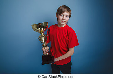 teenager boy twelve years old European appearance holds a...