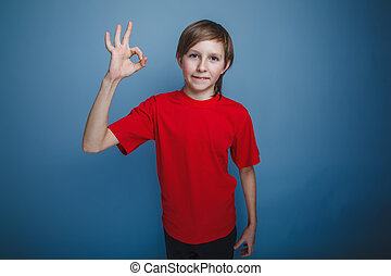 teenager boy twelve years old European appearance in a red...
