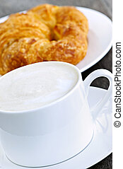 Latte coffee and croissant