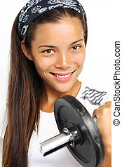 Fitness woman. Attractive woman lifting weights and smiling...