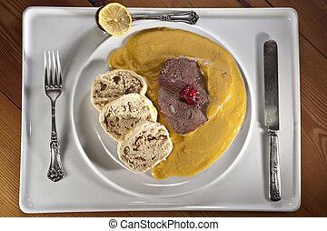 Braised beef in cream vegetable sauce with bread dumplings -...