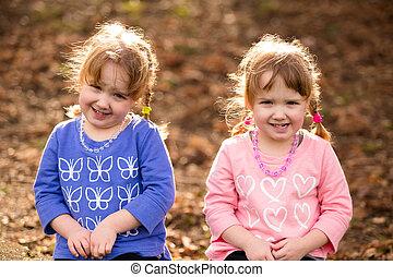 Identical Twins Lifestyle Portrait - Lifestyle portrait of...