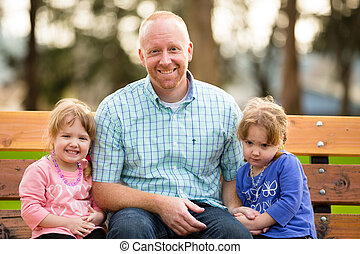 Father With Identical Twin Daughters - Dad with two...