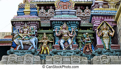 Meenakshi Amman Temple - Detail of colorful tower of...