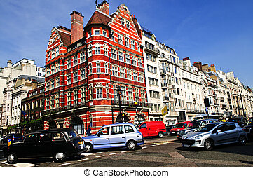 Busy street corner in London - London taxi on busy street...