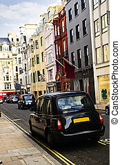London taxi on shopping street - London street with taxicab...