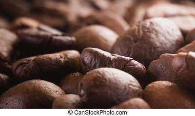A pile of roasted coffee beans rotating