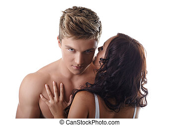 Sexy girl whispers in ear of handsome guy - Portrait of sexy...