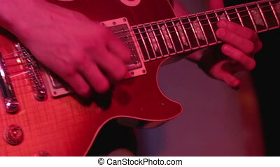 Electric guitar closeup - Concert performance. Playing on...