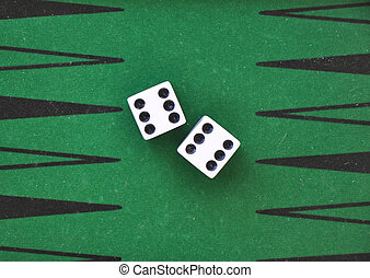 two dice on a green gaming table. - two dice on a green...