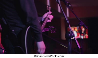 Two guitarists on the stage - Musicians on a concert