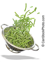 Colander with frozen green beans isolated on white