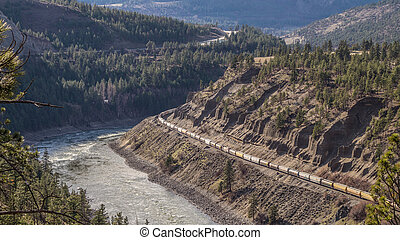 Long Train in the Fraser Canyon - 2 kilomoters (1.2 Miles)...