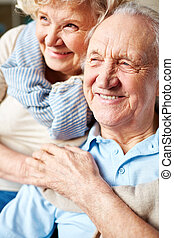 Togetherness - Happy senior couple in casualwear