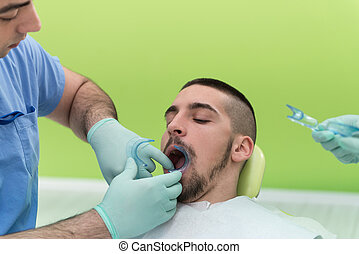 Close-Up Of Patient's Open Mouth During Oral Checkup