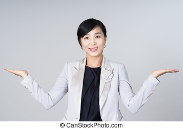 An attractive Asian woman grey background Studio images